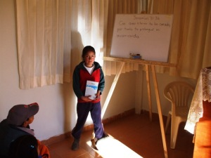Milagros receiving Bible