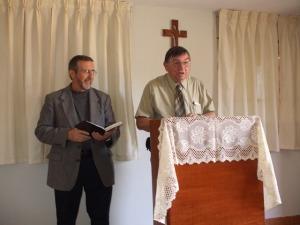 Pastor Gary preaching and Bro. Stanton translating