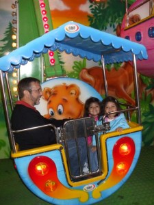 on the farris wheel with Papaw Stanton